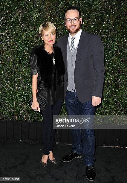 Actress Kristin Chenoweth and producer Dana Brunetti attend the Chanel and Charles Finch preOscar dinner at Madeo Restaurant on March 1 2014 in Los...
