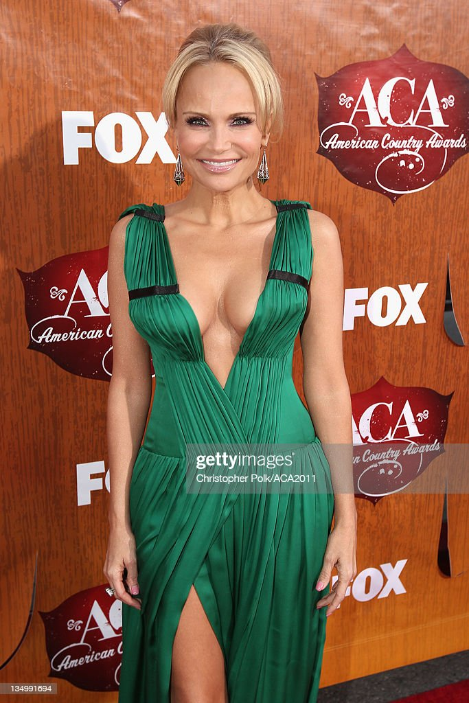 Actress Kristin Chenoweth arrives at the American Country Awards 2011 at the MGM Grand Garden Arena on December 5, 2011 in Las Vegas, Nevada.