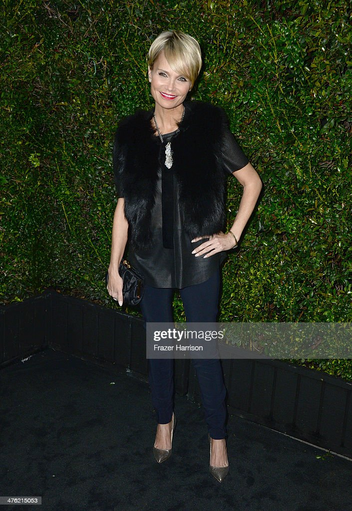Actress Kristin Chenoweth attends the Chanel and Charles Finch Pre-Oscar Dinner at Madeo Restaurant on March 1, 2014 in Los Angeles, California.