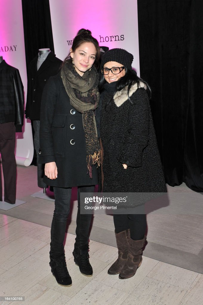 Actress <a gi-track='captionPersonalityLinkClicked' href=/galleries/search?phrase=Kristin+Kreuk&family=editorial&specificpeople=216415 ng-click='$event.stopPropagation()'>Kristin Kreuk</a> and Sima Kumar attend the Holt Renfrew opening night party on March 18, 2013 in Toronto, Canada.