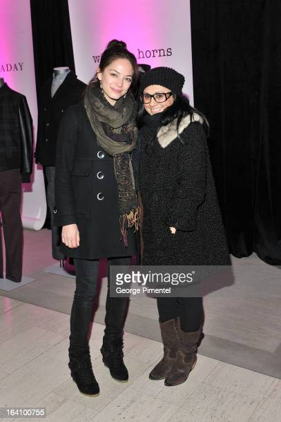 Actress Kristin Kreuk and Sima Kumar attend the Holt Renfrew opening night party on March 18 2013 in Toronto Canada