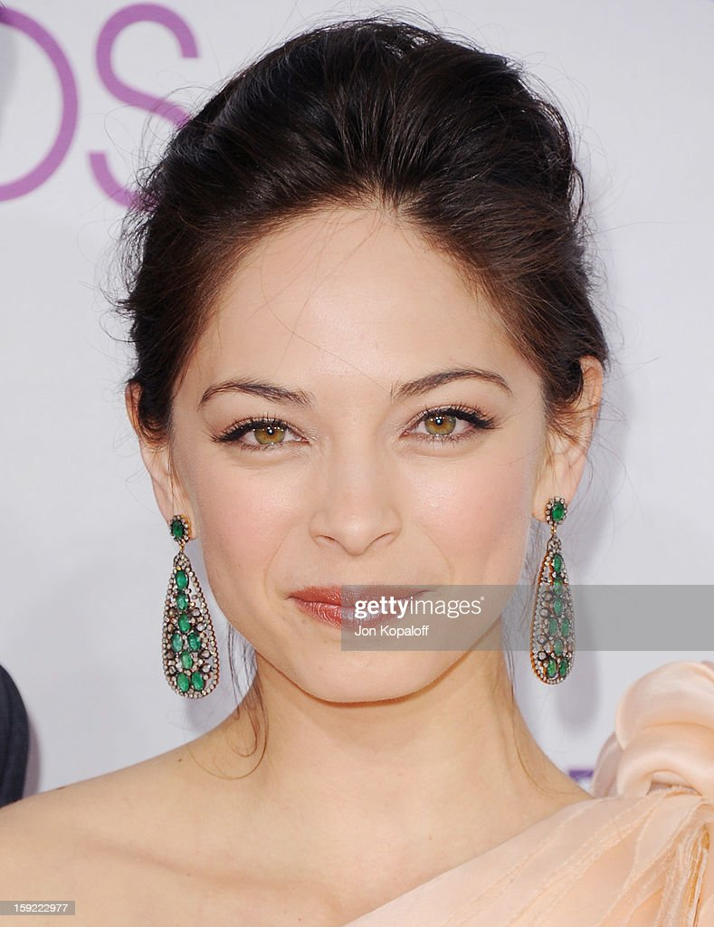 Actress <a gi-track='captionPersonalityLinkClicked' href=/galleries/search?phrase=Kristin+Kreuk&family=editorial&specificpeople=216415 ng-click='$event.stopPropagation()'>Kristin Kreuk</a> arrives at the 2013 People's Choice Awards at Nokia Theatre L.A. Live on January 9, 2013 in Los Angeles, California.