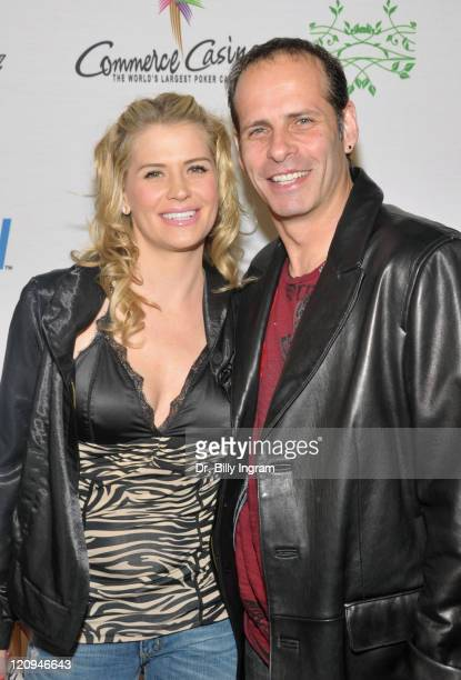 Actress Kristy Swanson and guest attend the 7th Annual World Poker Tour Invitational at Commerce Casino on February 28 2009 in Los Angeles California