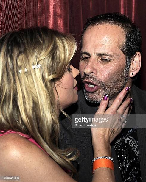 Actress Kristy Swanson celebrates her birthday by kissing her husband at LAX Nightclub at the Luxor Resort Casino on January 9 2010 in Las Vegas...