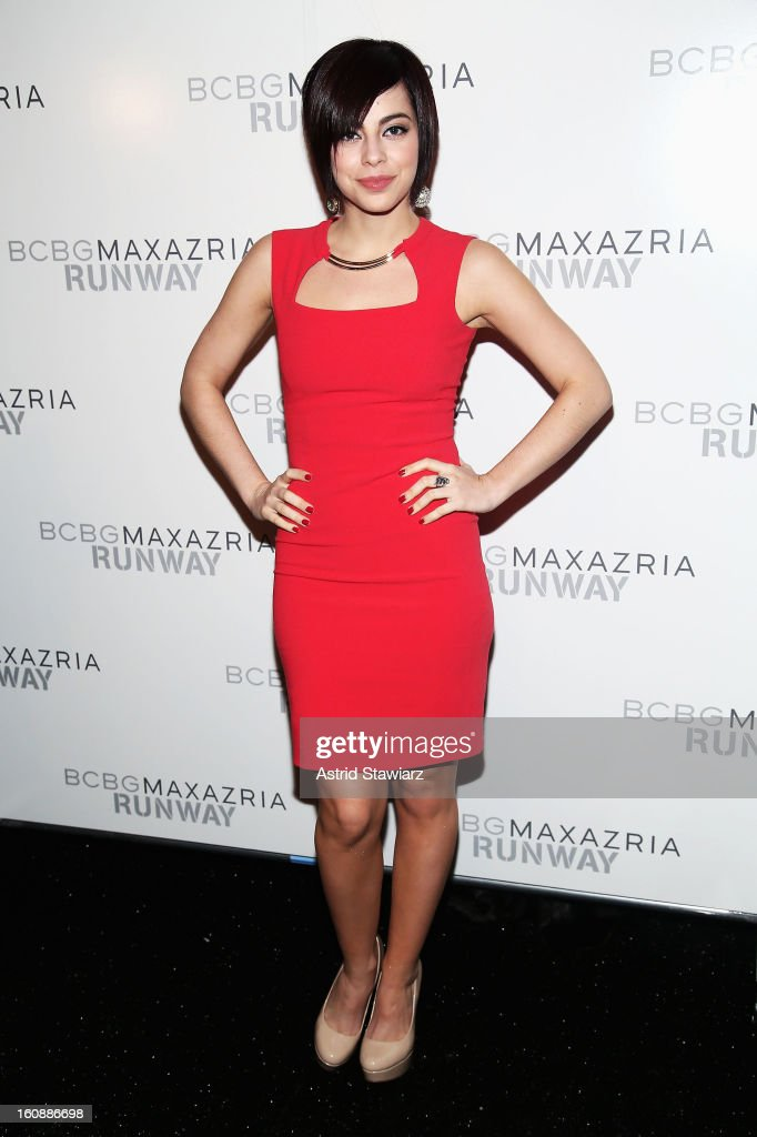 Actress Krysta Rodriguez poses backstage at the BCBGMAXAZRIA Fall 2013 fashion show during Mercedes-Benz Fashion Week at The Theatre at Lincoln Center on February 7, 2013 in New York City.