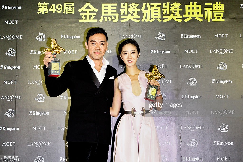 Actress Kwai Lun-Mei and actor Lau Ching-Wan pose with their trophies during the 49th Golden Horse Awards at the Luodong Cultural Working House on November 24, 2012 in Ilan, Taiwan.
