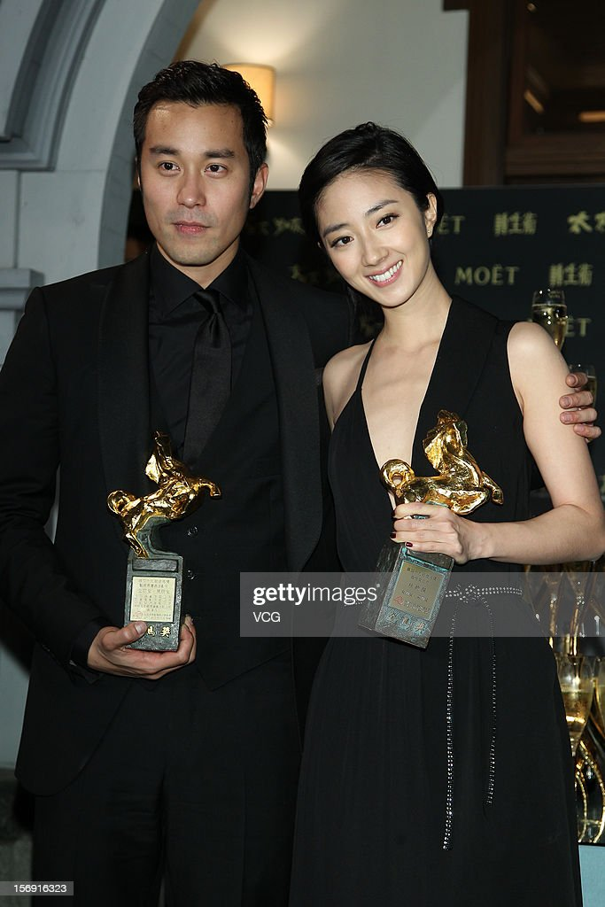 Actress Kwai Lun-Mei poses with actor Joseph Chang during a celebration after the 49th Golden Horse Awards on November 24, 2012 in Ilan, Taiwan.