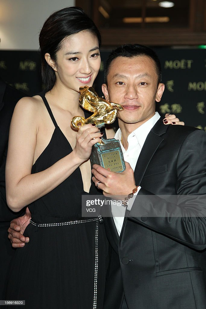 Actress Kwai Lun-Mei poses with director Ya-che Yang during a celebration after the 49th Golden Horse Awards on November 24, 2012 in Ilan, Taiwan.