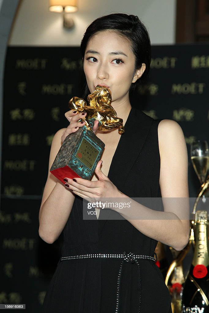 Actress Kwai Lun-Mei poses with her trophy during a celebration after the 49th Golden Horse Awards on November 24, 2012 in Ilan, Taiwan.