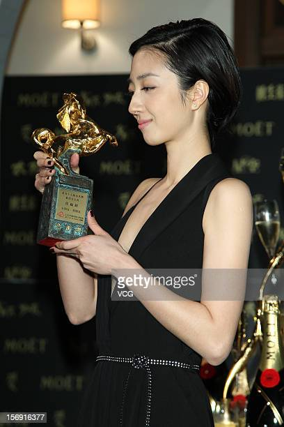 Actress Kwai LunMei poses with her trophy during a celebration after the 49th Golden Horse Awards on November 24 2012 in Ilan Taiwan