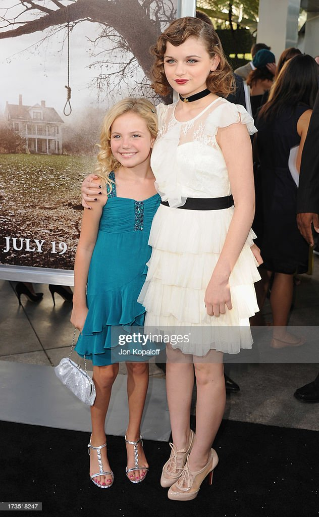 Actress Kyla Deaver and actress Joey King arrive at the Los Angeles Premiere 'The Conjuring' at ArcLight Cinemas Cinerama Dome on July 15, 2013 in Hollywood, California.