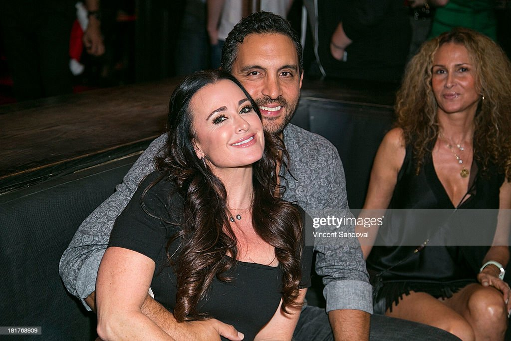 Actress Kyle Richards (L) and husband Mauricio Umansky attend The Abbey's 8th annual Christmas in September event benefiting The Children's Hospital Los Angeles at The Abbey on September 24, 2013 in West Hollywood, California.