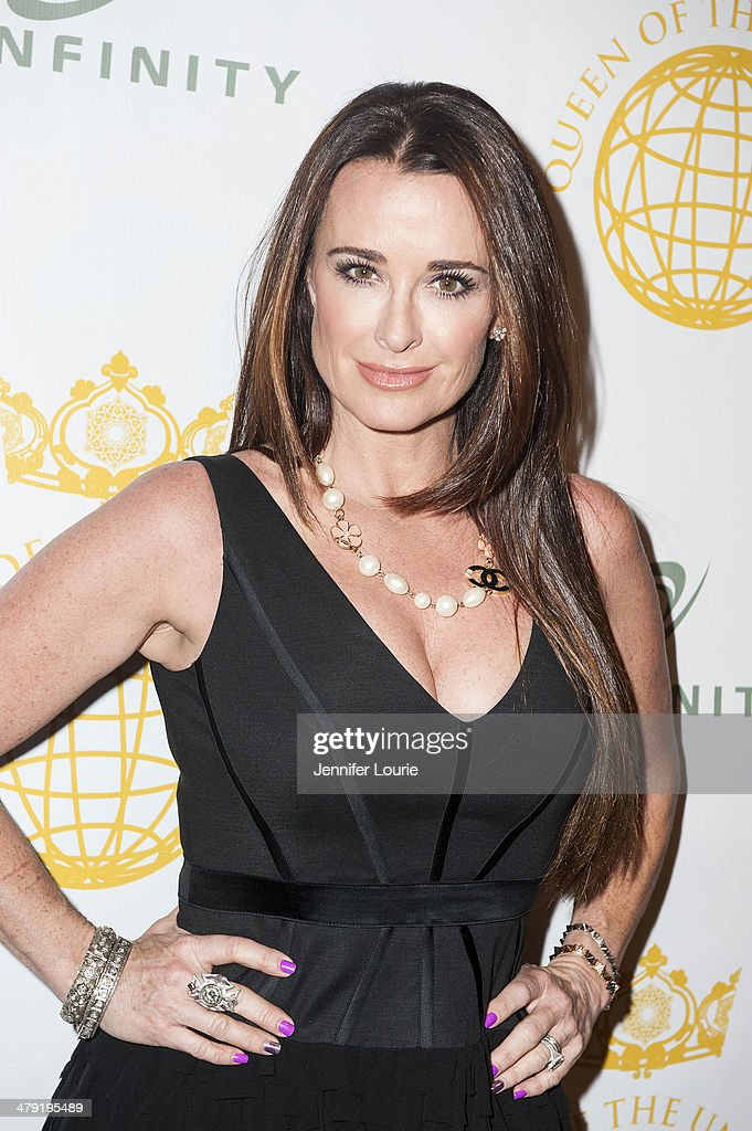 Actress <a gi-track='captionPersonalityLinkClicked' href=/galleries/search?phrase=Kyle+Richards&family=editorial&specificpeople=2586434 ng-click='$event.stopPropagation()'>Kyle Richards</a> attends the Queen Of The Universe International Beauty Pageant hosted at the Saban Theatre on March 16, 2014 in Beverly Hills, California.