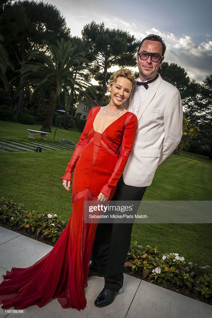 Actress <a gi-track='captionPersonalityLinkClicked' href=/galleries/search?phrase=Kylie+Minogue&family=editorial&specificpeople=201671 ng-click='$event.stopPropagation()'>Kylie Minogue</a> and hair colorist Christophe Robin are photographed at the amfAR gala for Paris Match on May 24, 2012 in Cap d'Antibes, France.