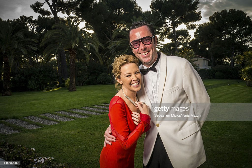 Actress Kylie Minogue and hair colorist Christophe Robin are photographed at the amfAR gala for Paris Match on May 24, 2012 in Cap d'Antibes, France.
