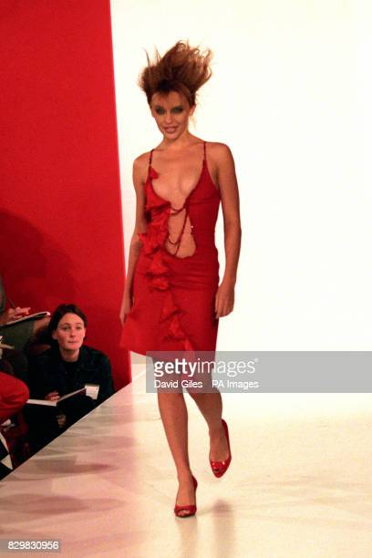 Actress Kylie Minogue takes to the catwalk in a tight fitting dress scooped to the navel today for the debut show of Antonio Berardi as part of...
