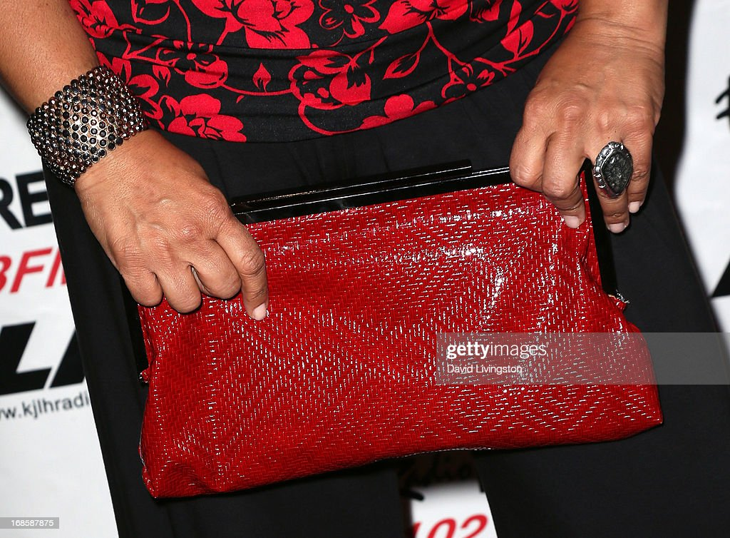 Actress <a gi-track='captionPersonalityLinkClicked' href=/galleries/search?phrase=Kym+Whitley&family=editorial&specificpeople=242929 ng-click='$event.stopPropagation()'>Kym Whitley</a> (purse detail) attends Stevie Wonder's 63rd birthday celebration at the House of Music & Entertainment on May 11, 2013 in Beverly Hills, California.