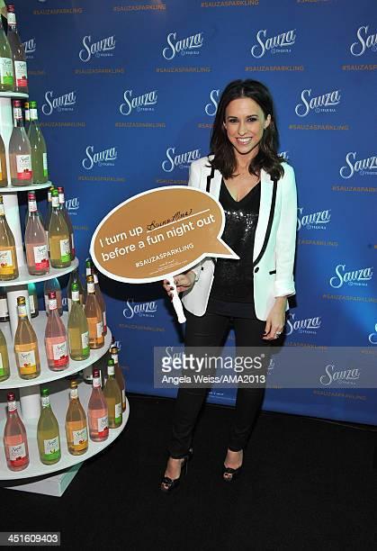 Actress Lacey Chabert attends day 2 of the 2013 American Music Awards gift lounge at Nokia Theatre LA Live on November 23 2013 in Los Angeles...
