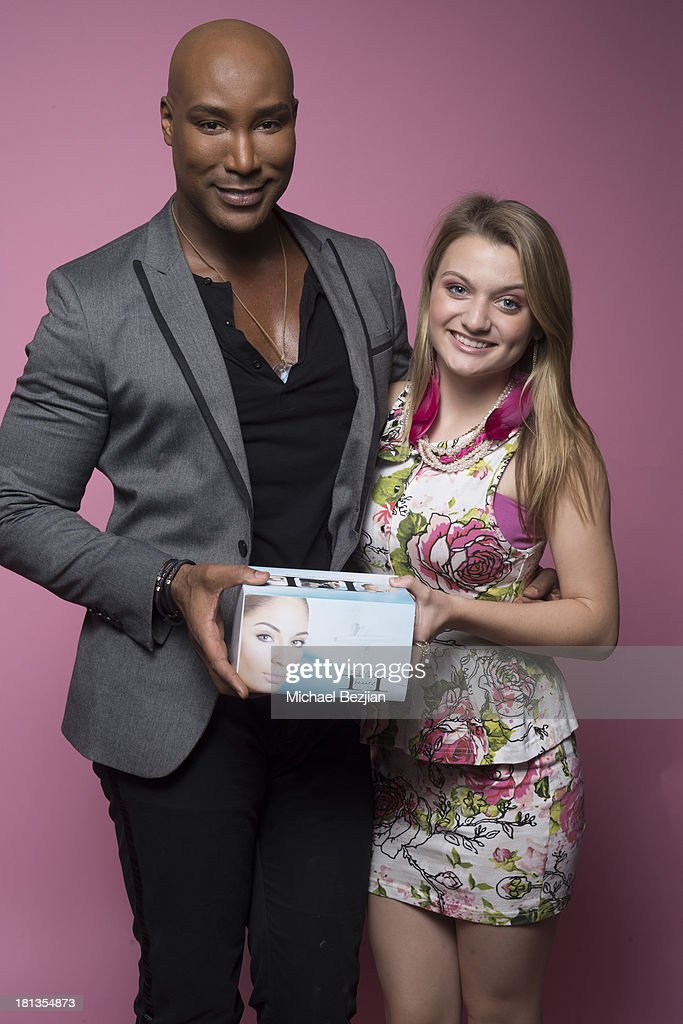 Actress Laci Kay (R) gets a gift from Marc Harvey of 'Element 2 Beauty' at the Mark Kearney Group 'Iced Out' Luxury Emmy Suite on September 19, 2013 in Los Angeles, California.