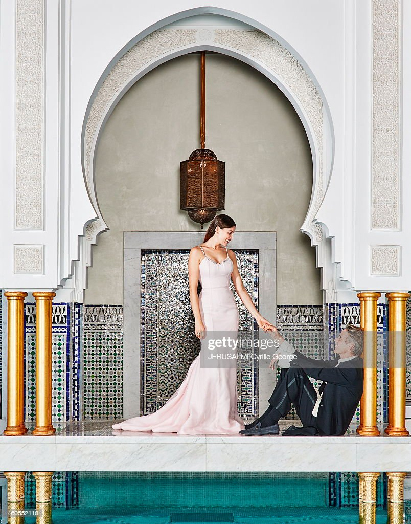 Actress Laetitia Casta wearing a dress Dior haute couture and Jeremy Irons pose in the garden of the Mamounia during the 14th Film Festival of...