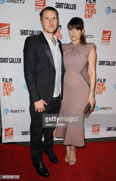 Actress Lake Bell and husband Scott Campbell attend the premiere of 'Shot Caller' at The Theatre at Ace Hotel on August 15 2017 in Los Angeles...