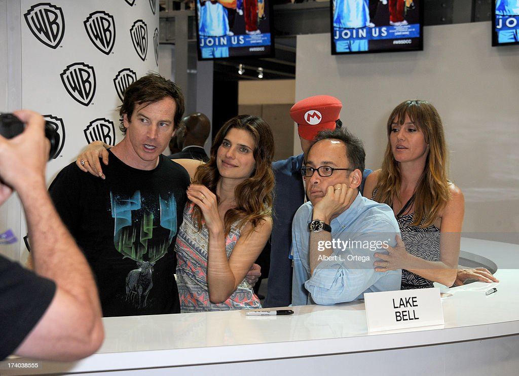 Actress Lake Bell (2nd from L) signs autographs during Comic-Con International at San Diego Convention Center on July 19, 2013 in San Diego, California.