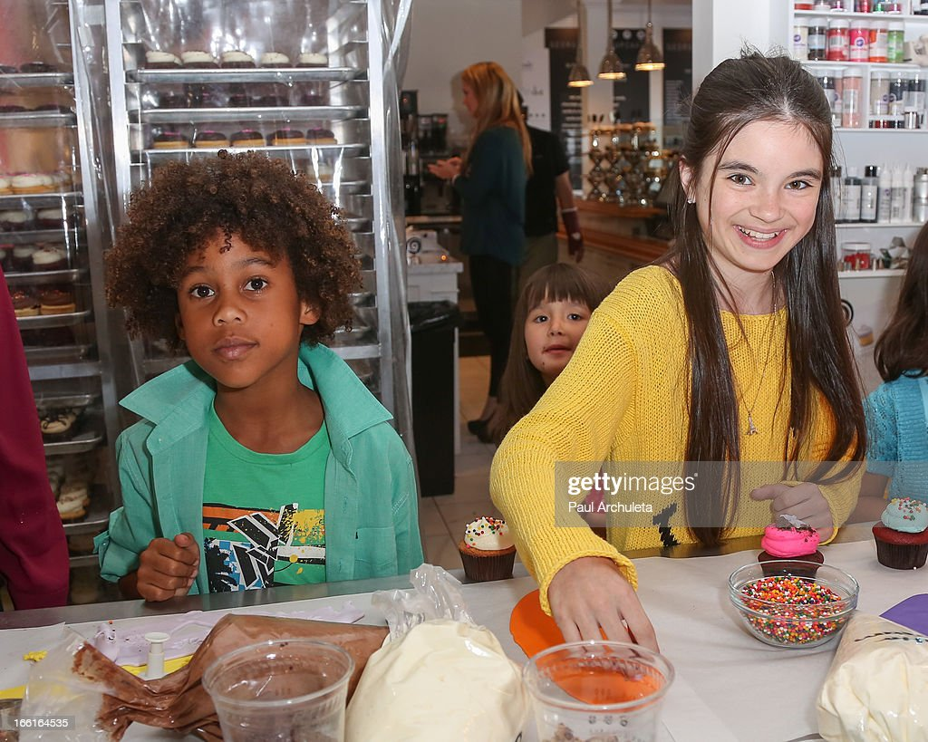 Actress Landry Bender (R) and Roman Peete (L)attend the Stella & Dot VIP Trunk Show benefiting The HollyRod Foundation at Georgetown Cupcake Los Angeles on April 8, 2013 in Los Angeles, California.