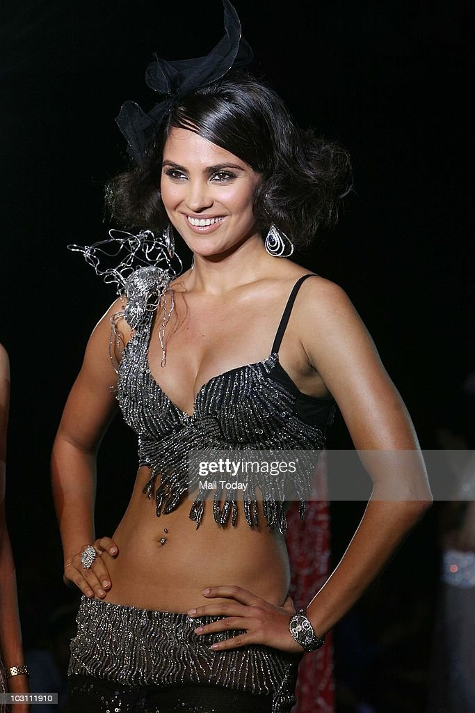 Actress Lara Dutta walks the ramp for designer Rina Dhaka at the final day of the Delhi Couture Week in New Delhi on July 25 2010