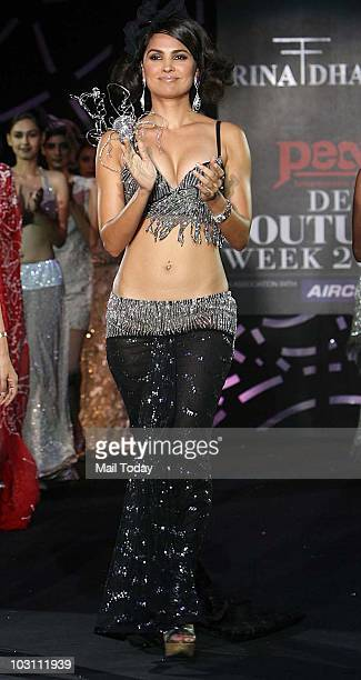 Actress Lara Dutta walks the ramp for designer Rina Dhaka at the final day of the Delhi Couture Week on July 25 2010