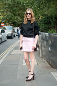 Actress Laura Carmichael is wearing Calvin Klein shoes Christopher Kane bag and Laura Spade sunglasses on day 4 of London Collections Women on...