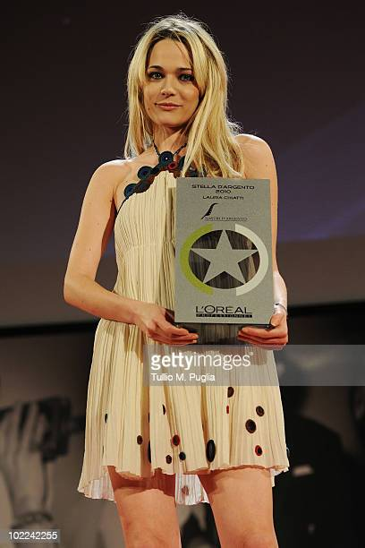 Actress Laura Chiatti poses with the special award 'Silver Star 2010' during the Nastri d'Argento ceremony awards on June 19 2010 in Taormina Italy