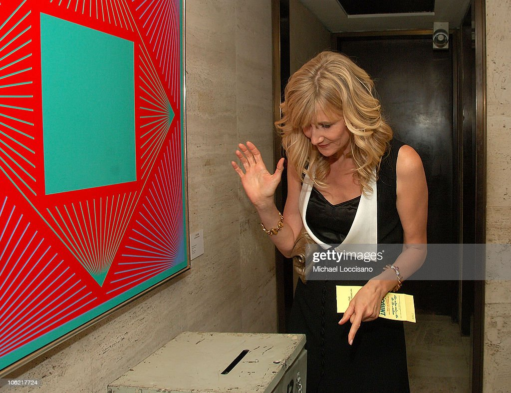 Actress <a gi-track='captionPersonalityLinkClicked' href=/galleries/search?phrase=Laura+Dern&family=editorial&specificpeople=204203 ng-click='$event.stopPropagation()'>Laura Dern</a> casts a ballots at the after party for the New York premiere of HBO Films' 'Recount', at The Four Seasons Restaurant in New York City on May 13, 2008.