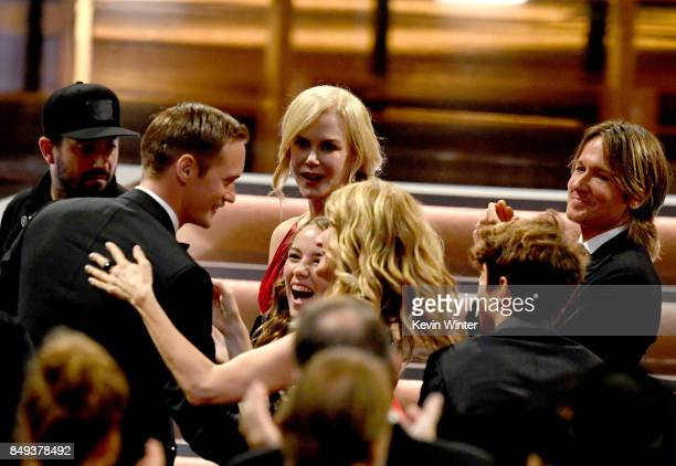 Actress Laura Dern congratulates actor Alexander Skarsgard before he accepts Outstanding Supporting Actor in a Limited Serier or Movie for 'Big...