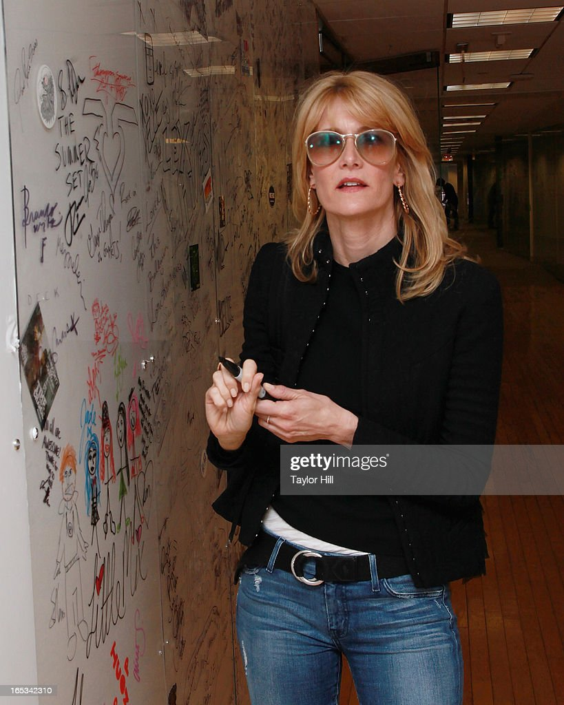 Actress Laura Dern signs the wall at SiriusXM Studios on April 2, 2013 in New York City.