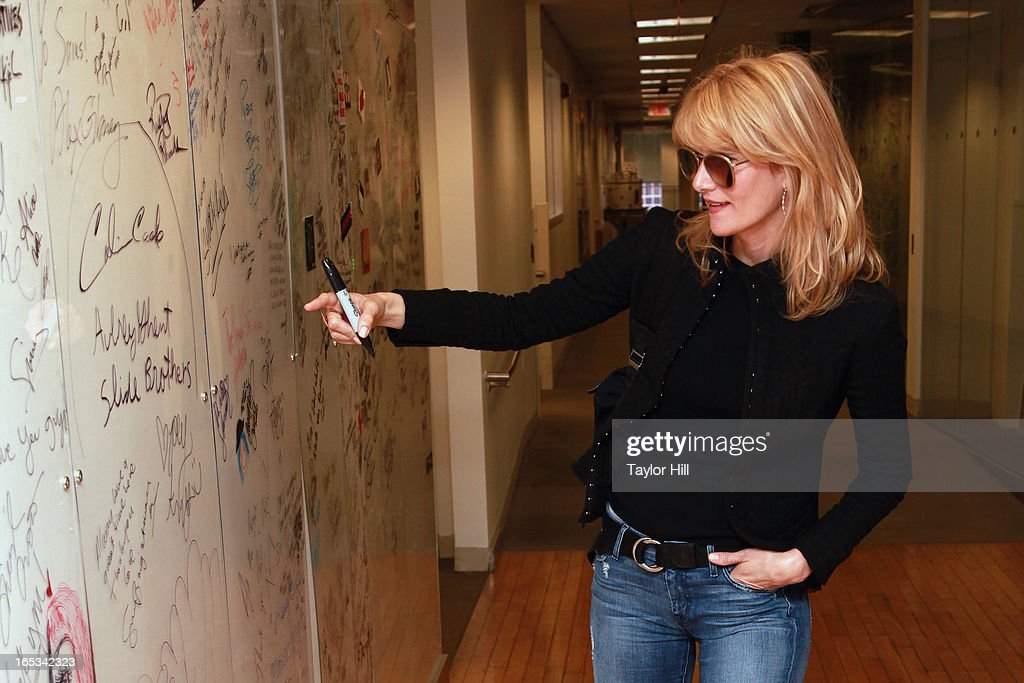 Actress <a gi-track='captionPersonalityLinkClicked' href=/galleries/search?phrase=Laura+Dern&family=editorial&specificpeople=204203 ng-click='$event.stopPropagation()'>Laura Dern</a> signs the wall at SiriusXM Studios on April 2, 2013 in New York City.