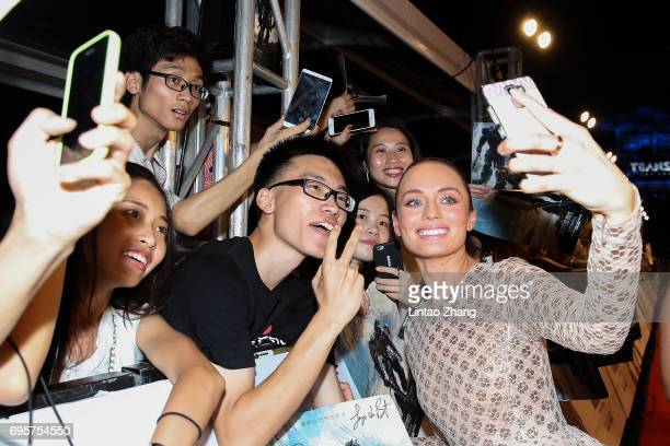 Actress Laura Haddock greets fans during the 'Transformers The Last Knight' China World Premiere and Ten Year Anniversary Celebration at Haixinsha...