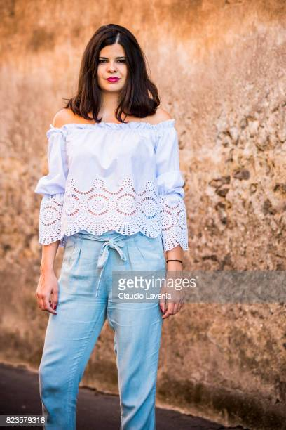 Actress Laura Ingiulla wearing blue white stripped blouse from Stradivarius and light blue pants from Stradivarius is seen on July 27 2017 in...
