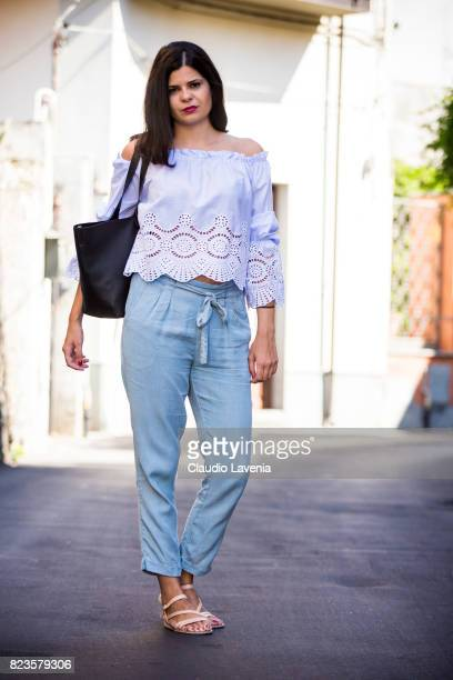 Actress Laura Ingiulla wearing blue white stripped blouse from Stradivarius light blue pants from Stradivarius Pull and Bear bag and Zuiki shoes is...