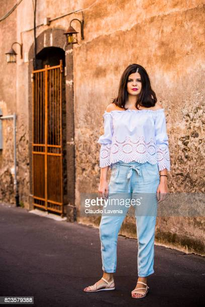 Actress Laura Ingiulla wearing blue white stripped blouse from Stradivarius light blue pants from Stradivarius and Zuiki shoes is seen on July 27...