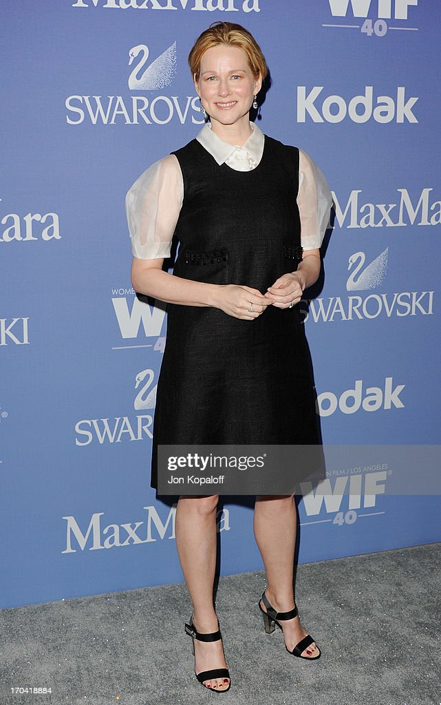 Actress <a gi-track='captionPersonalityLinkClicked' href=/galleries/search?phrase=Laura+Linney&family=editorial&specificpeople=171603 ng-click='$event.stopPropagation()'>Laura Linney</a> arrives at the 2013 Women In Film's Crystal + Lucy Awards at The Beverly Hilton Hotel on June 12, 2013 in Beverly Hills, California.