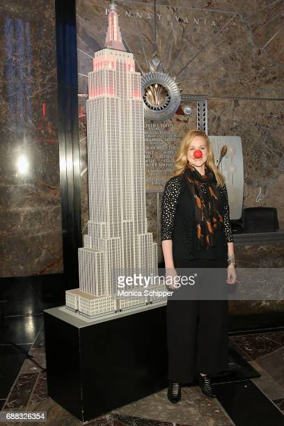 Actress Laura Linney lights The Empire State Building in honor of Red Nose Day at The Empire State Building on May 25 2017 in New York City