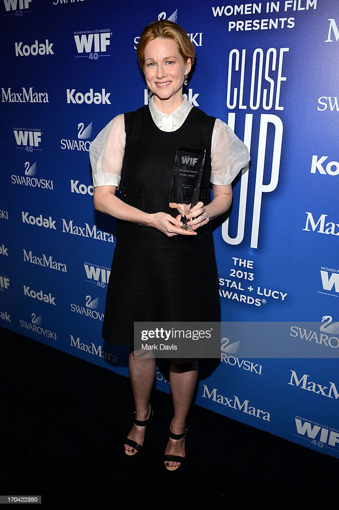 Actress <a gi-track='captionPersonalityLinkClicked' href=/galleries/search?phrase=Laura+Linney&family=editorial&specificpeople=171603 ng-click='$event.stopPropagation()'>Laura Linney</a> poses with the Crystal Award for Excellence in Film backstage at Women In Film's 2013 Crystal + Lucy Awards at The Beverly Hilton Hotel on June 12, 2013 in Beverly Hills, California.