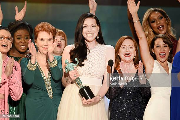 Actress Laura Prepon and the cast of 'Orange Is The New Black' accept the award for Oustanding Ensemble in a Comedy Series onstage during The 22nd...