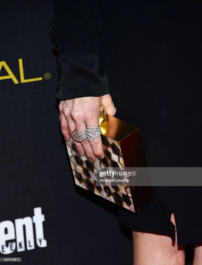 Actress Laura Prepon (clutch and ring detail) arrives at the 2014 Entertainment Weekly Pre-Emmy Party at Fig & Olive Melrose Place on August 23, 2014 in West Hollywood, California.
