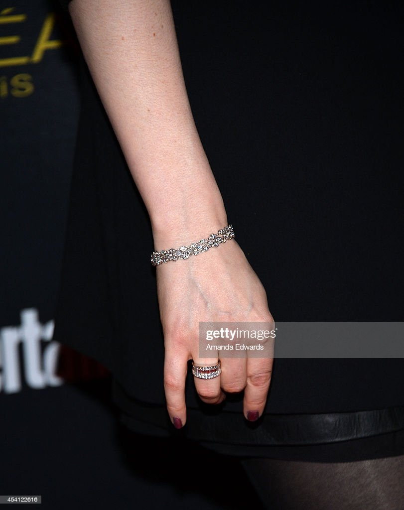 Actress Laura Prepon (jewelry detail) arrives at the 2014 Entertainment Weekly Pre-Emmy Party at Fig & Olive Melrose Place on August 23, 2014 in West Hollywood, California.