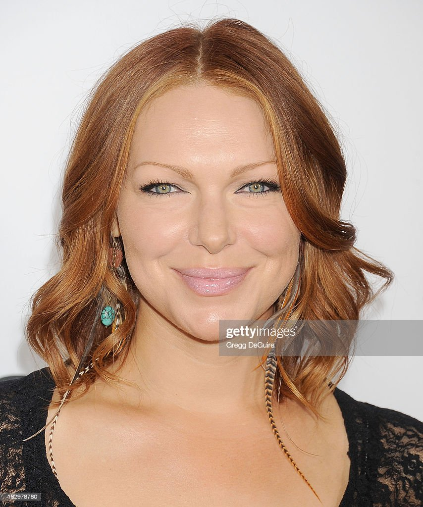 Actress Laura Prepon arrives at the Los Angeles premiere of 'Machete Kills' at Regal Cinemas L.A. Live on October 2, 2013 in Los Angeles, California.