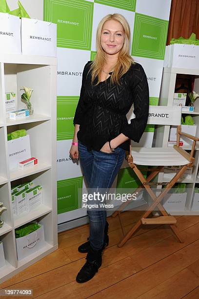 Actress Laura Prepon poses with Rembrandt at Kari Feinstein's Oscars Style Lounge at Mondrian Los Angeles on February 24 2012 in West Hollywood...