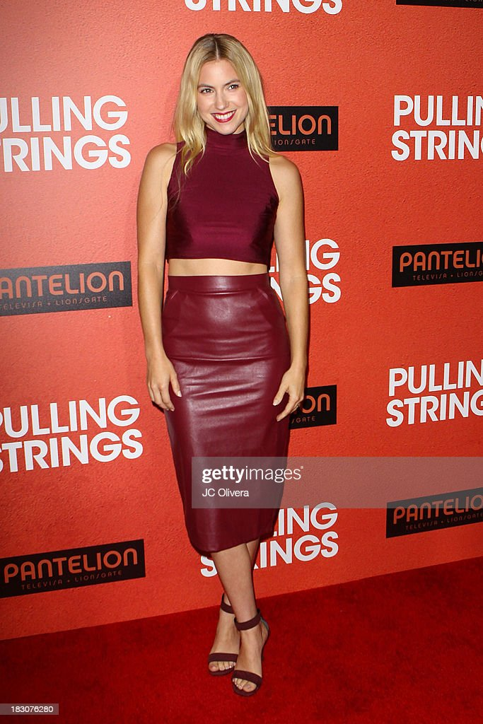 Actress <a gi-track='captionPersonalityLinkClicked' href=/galleries/search?phrase=Laura+Ramsey&family=editorial&specificpeople=649583 ng-click='$event.stopPropagation()'>Laura Ramsey</a> attends the Los Angeles Premiere of 'Pulling Strings' at Regal Cinemas L.A. Live on October 3, 2013 in Los Angeles, California.