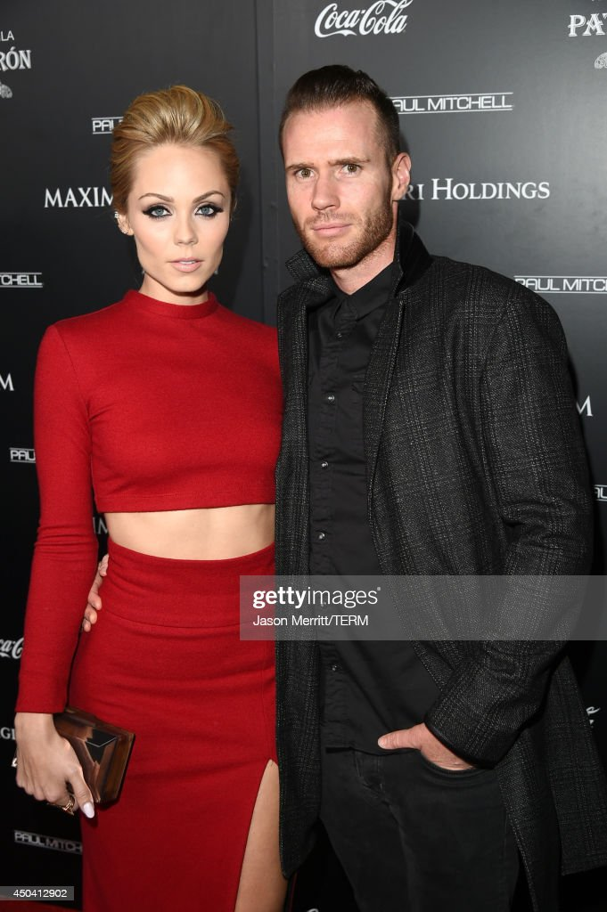 Actress Laura Vandervoort (L) and TV personality Oliver Trevena attend Maxim's Hot 100 Women of 2014 celebration and sneak peek of the future of Maxim at Pacific Design Center on June 10, 2014 in West Hollywood, California.