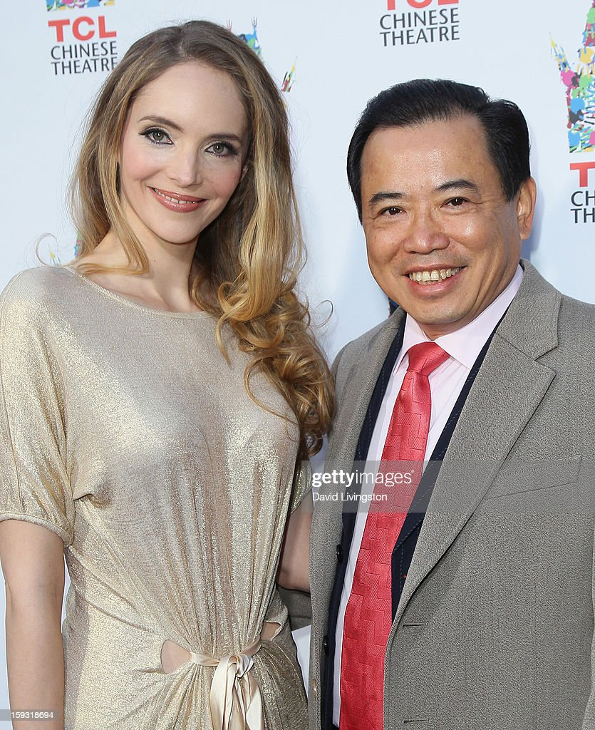 Actress Laura Weissbecker (L) and TCL Chairman Li Dongsheng attend the renaming of Grauman's Chinese Theatre to the TCL Chinese Theatre at the Chinese Theatre on January 11, 2013 in Hollywood, California.